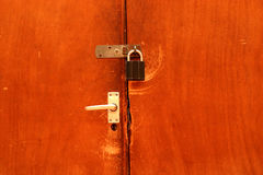 Old doors. Pair of old wooden doors with hasp,staple and padlock Stock Images