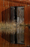 Old doors. Old wooden doors by water Stock Photo