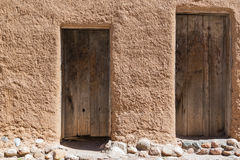 Old doors on adobe wall Royalty Free Stock Photography