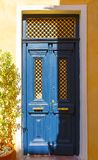 Old doors blue wood with evening soft sunlight of Greek island Crete stock image