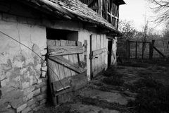 Old doors of the chicken coop. In the backyard in the countryside. Its was used until a few years ago for breeding hens and roosters Royalty Free Stock Images
