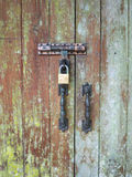 Old doors are locked with a key. Stock Photography