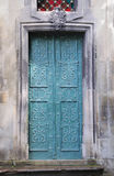 Old doors. Metallic blue door at the entrance to the church stock photo