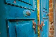 Old doors with padlocks safety concept. Royalty Free Stock Image