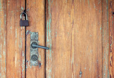 Old doors with rusty door handle and padlock Stock Photo