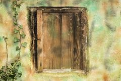 Old doors on smokehouse. Old doors on little smokehouse royalty free stock images