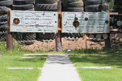 Old Doors And Tires Used For Target Practice. Old steel doors and tires piled in front of a berm at an outdoor shooting range Royalty Free Stock Images