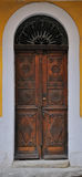 Old doors. Wooden vintage door with beautiful patterns Royalty Free Stock Photo