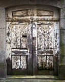 Old doorward, weathered and rotting in Porto Royalty Free Stock Images