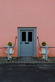 Old doorway with pink wall Stock Images