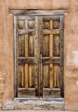 Old Doorway. An old doorway in a southwest pueblo style structure on a side street of Santa Fe, New Mexico Royalty Free Stock Images