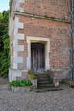 Old doorway. Old steps and doorway at Doddington Hall, England, UK Royalty Free Stock Images