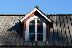 Old dormer window. Dormer window on old wooden house Stock Photo