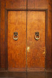 Old double door with doorknocker. In italy royalty free stock photography