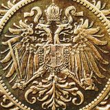 Old double eagle background. Background based on double eagle detail from an old Austrian 2 heller coin Royalty Free Stock Photo