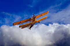Double winged propeller plane flying Stock Photos