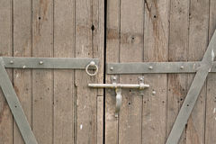 Old double wooden door. With metal hinges and lock stock photography