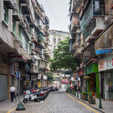 Old downtown street in Macau. MACAU - DECEMBER 1: view on downtown street on December 1, 2012 in Macau, China. Macau features a strong tourism industry based on Royalty Free Stock Image
