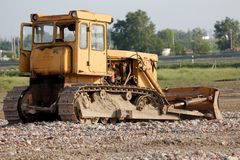 Old Dozer. At a construction site royalty free stock photography