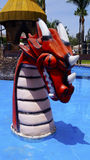Old dragon sculpture in a water park. A big red head of a dragon in a water park in mexico in a kids pool whit bright colors and clear water Stock Photography