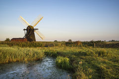 Old drainage windpump windmill in English countryside landscape Royalty Free Stock Photos