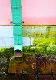 Old drainpipe on the wall. stock photo