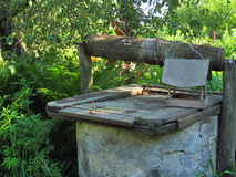 Old draw-well. In an abandoned yard Royalty Free Stock Photos