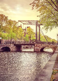Old drawbridge in Amsterdam city over river Amstel Royalty Free Stock Photos