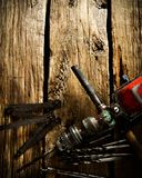 Old drill, ruler and drills on wooden background Royalty Free Stock Photo