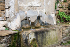 Old drinking fountain, Jeravna, Bulgaria, Europe. Close-up view of old drinking fountain, Jeravna, Bulgaria, Europe Stock Photo
