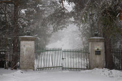 Old driveway gate in winter Stock Photos