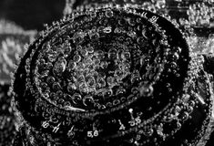 Old drowned camera lens under water Stock Images