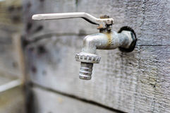 Old dry faucet no water danger Stock Images