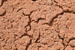 Old dry red crushed bricks surface on outdoor tennis ground. Detail of texture Royalty Free Stock Images