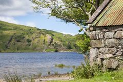 Stone Boat House by Lake. Old dry stone boat house by a lake in the Beara Peninsula in County Kerry Royalty Free Stock Images