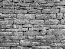 Old dry stone stone wall with no cement made of gritstone royalty free stock photo