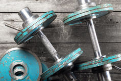 The old dumbbell on wooden floor. Royalty Free Stock Images