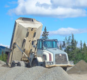 An old dumptruck at a rustic quarry in the yukon Royalty Free Stock Images