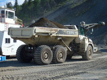 An old dumptruck at a rustic stone-crushing quarry in the yukon Royalty Free Stock Photo
