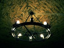 Old dungeon lantern. Ceiling lantern illuminating dungeon ceiling stock images