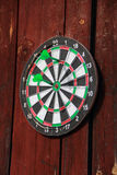 Dartboard on the wall Royalty Free Stock Photo