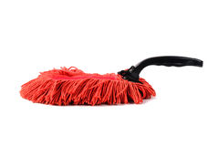 Old dust brush or red fabric mop, isolated Stock Photo
