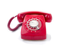 Old and dust red retro phone on white. Stock Image