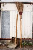 Old dustpan and broom. On the floor Stock Images