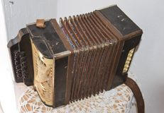 Old dusty accordion. Musical instruments of the Russian village Royalty Free Stock Photos