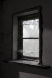 Old dusty barn window. With a lot of spider web Stock Images