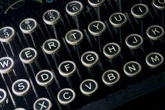 Old dusty black typewriter keyboard. Isolated old dusty black typewriter keyboard Royalty Free Stock Images