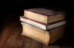 Old dusty books on table. Stock Image