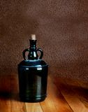 Old dusty bottle on table vintage Royalty Free Stock Images