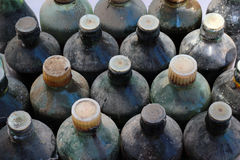 Old dusty bottles. Old dusty closed bottles as a background Stock Photos